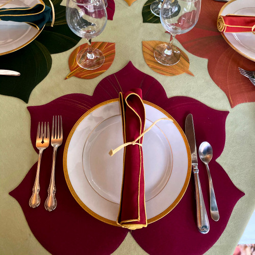 One Sweet Leaf Placemat with one rolled gold-trimmed burgundy napkin. Coasters shown in photo, above,  sold separately.