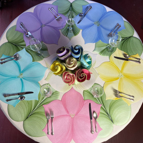 5 Sweet Leaves alternate with 5 Wild Lilies in assorted pastels, as shown. (Click on the links for the springtime floral bouquet https://www.caroleshiber.com/napkin-bouquets-the-sustainable-alternative/or coordinating napkins at https://www.caroleshiber.com/color-trimmed-napkins/ .)