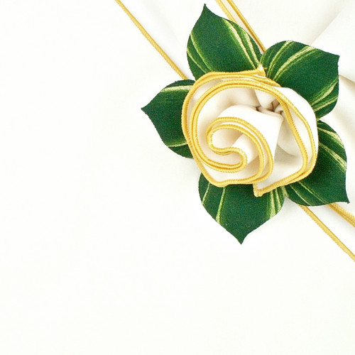 White Gold napkin with Pine Gold Napkin Ring