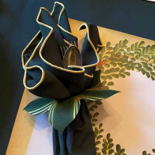 Rectangular Placemat with gold-tipped forest green napkin and leafy napkin-ring-to-coaster.
