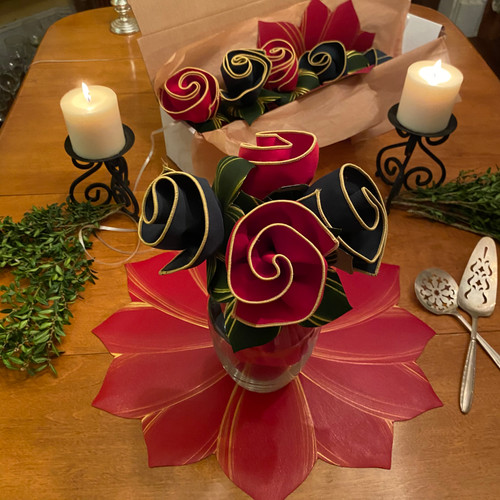 A perfect gift for this holiday season: four Botanic Napkins with leafy Ring-to-Coasters are framed by a hand-painted Poinsettia Placemat/Centerpiece and comes gorgeously boxes (top of photo).