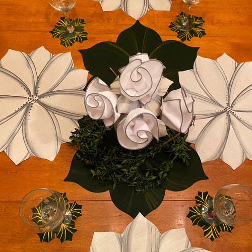 Hand-painted year-round beauty: Two White/Silver Floral Placemats, two pine interlocking leaves & 4 white/silver napkins with pine napkin rings, with 4 complementary hollyberry coasters ($26 value).