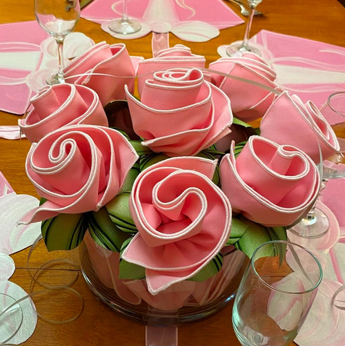 Set of 6 pink/white napkins with mint/pine leafy napkin rings. (this bouquet shows 6 in the front, but entire bouquet shows 9 stems.)
