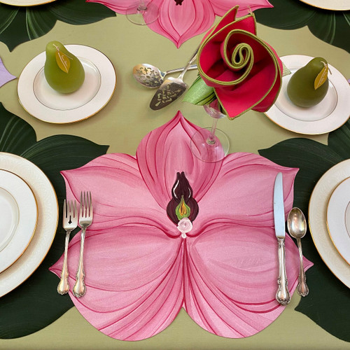 Pink Orchid presents itself between two Leaf Placemats in Pine/Frost, shown with floral napkin in hot pink/honeydew with leafy ring in mint.