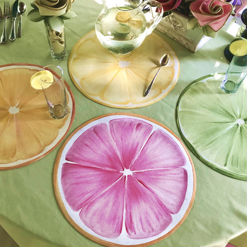 "Four 15"" Round Placemat set includes pink grapefruit, orange, lemon and lime slices, printed on textured vinyl canvas. Made in USA."