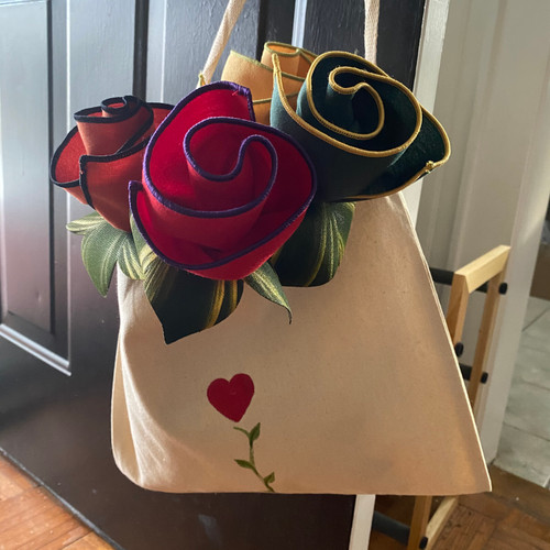 Four botanic napkins with hand-painted Leafy Napkin Rings are gathered in this Love Grows Tote, hand-painted on cotton canvas by Carole Shiber.