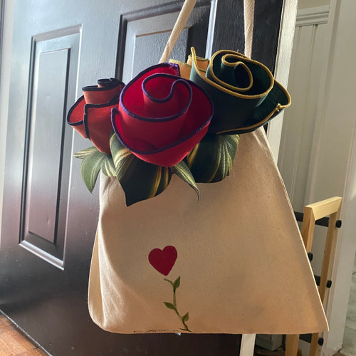 "Four assorted napkins and leafy rings come rolled up like in one of Carole's hand-painted aDOORable 12"" cotton canvas totes. What a great gift!"