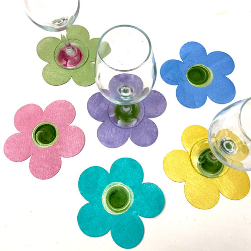 Set of 6 hand-painted coasters includes yellow, light blue, mint, pink, lilac and aqua, with coordinating swirly centers.