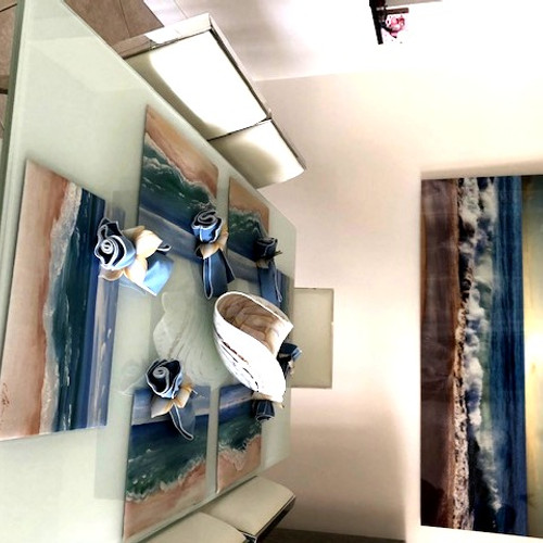 Ask Carole to paint a custom tablescape for your home. This customer asked Carole if she could paint placemats to coordinate to her seascape diningroom photograph. Each placemat is one-of-a-kind, yet pieces together to recreate the seascape on the table. Each placemat section was a joy to design and paint.
