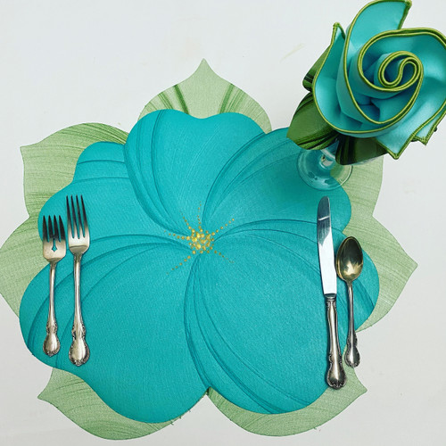 Complete 4-Piece Place-Setting includes Aqua Buttercup layered over Mint Leaf Placemat, Aqua/Honeydew Napkin rolled up into Leafy Napkin Ring in Pine/Frost, as shown. Call for other colorways, which are also available; such as pink over mint, lilac over mint, yellow over pine/frost with matching napkins & rings. 845-339-4646