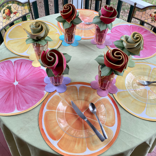 Six complete place-settings include 2 orange, 2 lemon & 2 pink grapefruit ARTPrints Placemats, assorted easy-care colorful napkins to coordinate, rolled up with Carole's Leafy Green Napkin Rings , and 6 BONUS hand-painted Flower Power Coasters to scatter around or under the glasses!