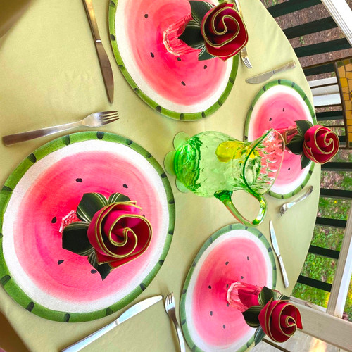 """Four complete place-settings include 4  ARTPrints 15"""" watermelon round placemats, deep pink/honeydew easy-care napkins and hand-painted Leafy Napkin Rings."""