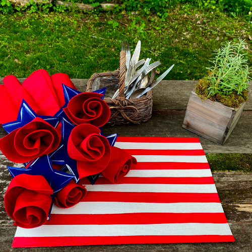 Shown here, 6 napkins and rings with one striped centerpiece placemat.