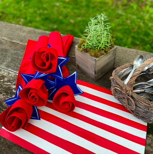 """17 x 12"""" hand-striped placemat/centerpiece sets the stage for Summer gatherings, with red napkins rolled up in hand-painted star napkin rings! (shown here, 4 napkins and rings are shown here, but this item ships you 6 napkins and rings.)"""