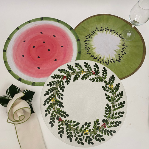 """Assorted 15"""" Rounds -- These three of Carole Shiber's ARTPrints Placemats cover every season with equal artistry as Watermelon, Kiwi and Christmas Wreath. Easy-care, made in USA."""