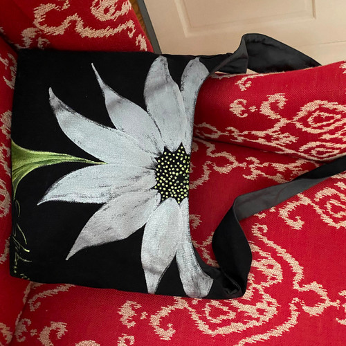 This Carole's (own) Signature Silver Rising Sunflower Shoulder Bag. She'll paint one for you, too! On cotton canvas with silver lining and inner zipper pocket. Nice long strap goes cross-style or will handsomely knot to shorten.