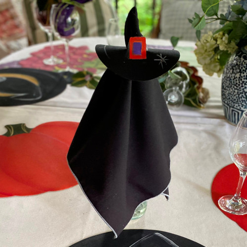 This happy halloween napkin doll includes one easy-care black/silver napkin with its hand-painted hat ring-to-coaster. Drop over a wine bottle, as shown, or stand up on its own in front of each witch or warlock at the table.