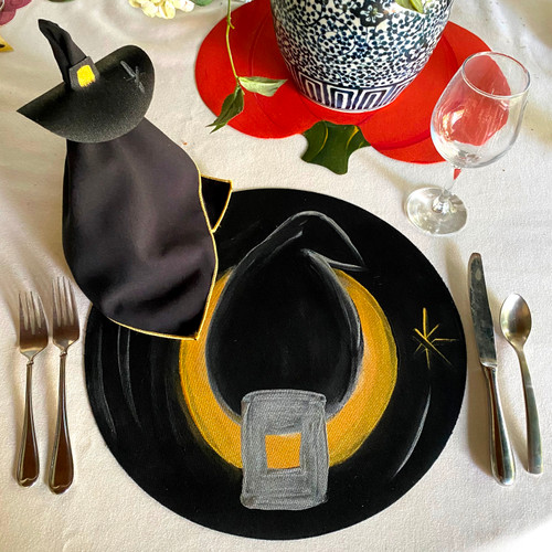 """Hand-Painted Witch's Hat 15"""" Round Placemat; for Napkin Doll, shown right, add the Napkin and Ring Option. Alternate with the Great Pumpkin for more seasonal fun and beauty."""