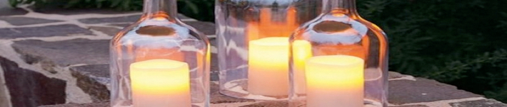 glass bottles being used as candle holders