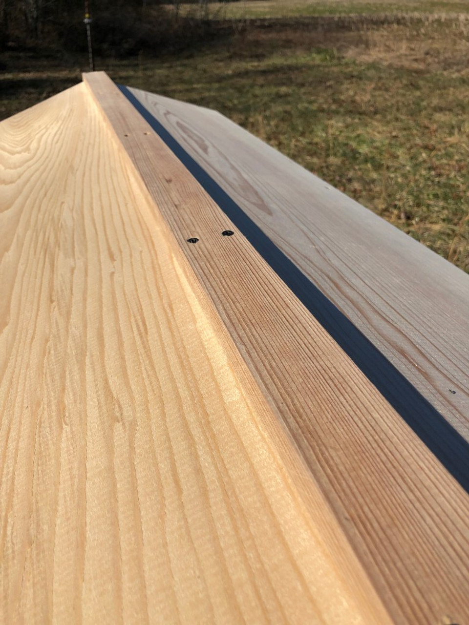 This is the roof ridge of the Gold Star top bar hive.  Sustainably harvested cypress stands up beautifully to the vagaries of life outside in your apiary.