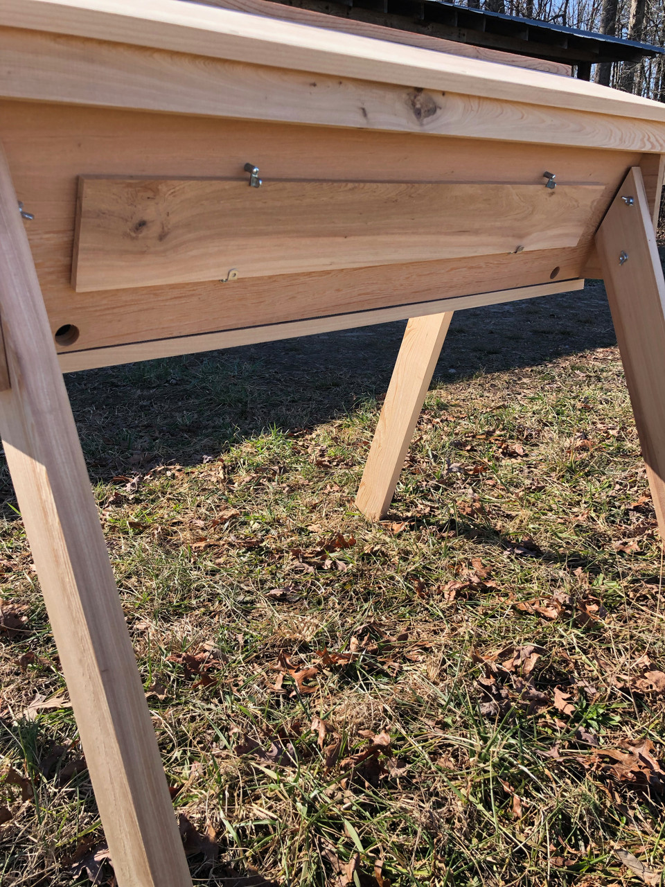 The Gold Star top bar hive has two rear entrances.  This feature, combined with the two included follower boards makes this hive extremely versatile, allowing for easy hive splits, and for housing two colonies in the same hive when necessary.
