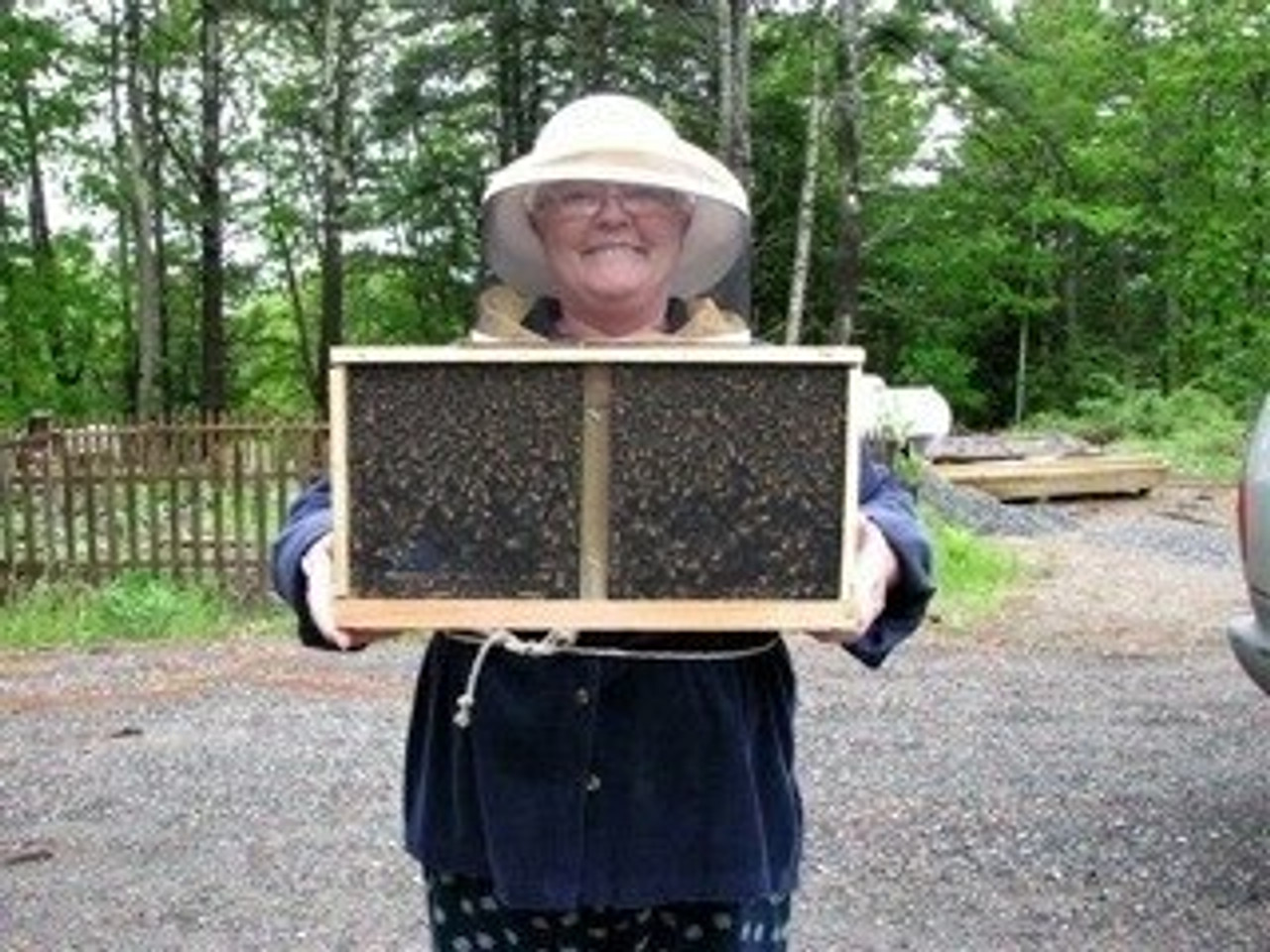 Another happy customer with her beautiful 3# package of honey bees.