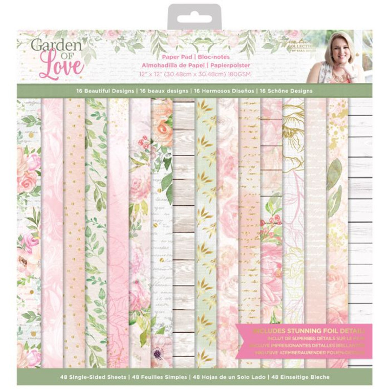 """Crafter's Companion - Sara Signature Garden of Love - 12 x 12  Capture the essence of sweet love and floral romance with the Sara Signature Garden of Love collection! Infused with soft colours, beautiful sentiments and delicate textures, this is the perfect range for wedding stationery, cardmaking and stunning invitations.  The stunning 12"""" x 12"""" paper pad is absolutely ideal for adding a touch of beauty to your projects with its gorgeous blush pinks, dainty flower prints and modern textures.  Each sheet measures 12"""" x 12"""", so they're ideal for using with die-cutting machines to cut out precise elements or with embossing folders for raised details. With 48 single-sided sheets and three sheets of each of the 16 designs, this means that you'll have plenty of opportunities to create as many cards and scrapbook pages as you like.  Collect the whole Garden of Love range to bring your romantic designs to life!"""