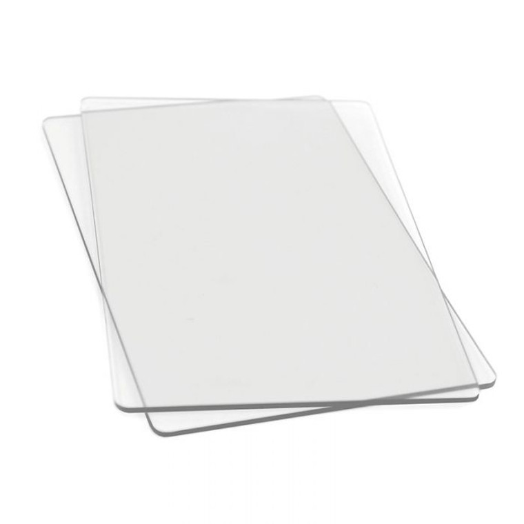 Sizzix Accessory - Cutting Pads, Standard, 1 Pair (655093)  This pair of Cutting Pads was specially designed for use in the BIGkick, Big Shot and Vagabond machines. Constructed of high-quality polycarbonate plastic, these see-through Cutting Pads allow for easy die-cutting of Sizzix steel-rule dies (Bigz, Movers & Shapers, Originals and ScoreBoards) in the BIGkick, Big Shot and Vagabond machines. Simply sandwich the die and material to be cut between the Cutting Pads and roll through the machine. A Premium Crease Pad may be needed in place of one Cutting Pad when die-cutting Sizzix steel-rule dies containing crease rule.