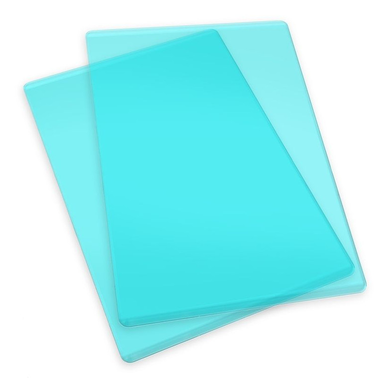 Sizzix Accessory - Cutting Pads - Standard - 1 Pair - Mint (660522)  This pair of Cutting Pads was specially designed for use in the BIGkick, Big Shot and Vagabond machines. Constructed of high-quality polycarbonate plastic, these see-through Cutting Pads allow for easy die-cutting of Sizzix steel-rule dies (Bigz, Movers & Shapers, Originals and ScoreBoards) in the BIGkick, Big Shot and Vagabond machines. Simply sandwich the die and material to be cut between the Cutting Pads and roll through the machine. A Premium Crease Pad may be needed in place of one Cutting Pad when die-cutting Sizzix steel-rule dies containing crease rule.
