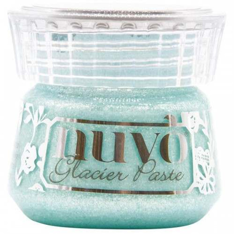 Nuvo - Glacier Paste - Sea Sprite (1904N)  Glam things up a notch and give your craft extra shine with our Nuvo Glacier Paste - use in combination with any stencil to create dimensional designs or bring texture and sparkle to larger areas and projects. Alternatively, rub into the surface using your finger, a dauber or brush to create a translucent shimmering finish. Available in multiple light-catching shades this metallic paste is easy to apply and packed with reflective mica flakes, giving your project that extra bit of dazzle. The pastes are beautifully effective on a variety of materials, including fabric, acetate, glass and wood, making this versatile product the perfect choice for papercraft and other mediums.Glam things up a notch and give your craft extra shine with our Nuvo Glacier Paste - use in combination with any stencil to create dimensional designs or bring texture and sparkle to larger areas and projects. Alternatively, rub into the surface using your finger, a dauber or brush to create a translucent shimmering finish. Available in multiple light-catching shades this metallic paste is easy to apply and packed with reflective mica flakes, giving your project that extra bit of dazzle. The pastes are beautifully effective on a variety of materials, including fabric, acetate, glass and wood, making this versatile product the perfect choice for papercraft and other mediums.