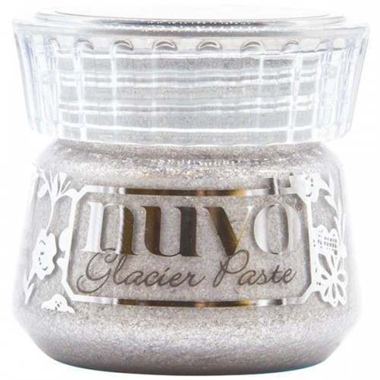 Nuvo - Glacier Paste - Quicksilver (1903N)  Glam things up a notch and give your craft extra shine with our Nuvo Glacier Paste - use in combination with any stencil to create dimensional designs or bring texture and sparkle to larger areas and projects. Alternatively, rub into the surface using your finger, a dauber or brush to create a translucent shimmering finish. Available in multiple light-catching shades this metallic paste is easy to apply and packed with reflective mica flakes, giving your project that extra bit of dazzle. The pastes are beautifully effective on a variety of materials, including fabric, acetate, glass and wood, making this versatile product the perfect choice for papercraft and other mediums.Glam things up a notch and give your craft extra shine with our Nuvo Glacier Paste - use in combination with any stencil to create dimensional designs or bring texture and sparkle to larger areas and projects. Alternatively, rub into the surface using your finger, a dauber or brush to create a translucent shimmering finish. Available in multiple light-catching shades this metallic paste is easy to apply and packed with reflective mica flakes, giving your project that extra bit of dazzle. The pastes are beautifully effective on a variety of materials, including fabric, acetate, glass and wood, making this versatile product the perfect choice for papercraft and other mediums.