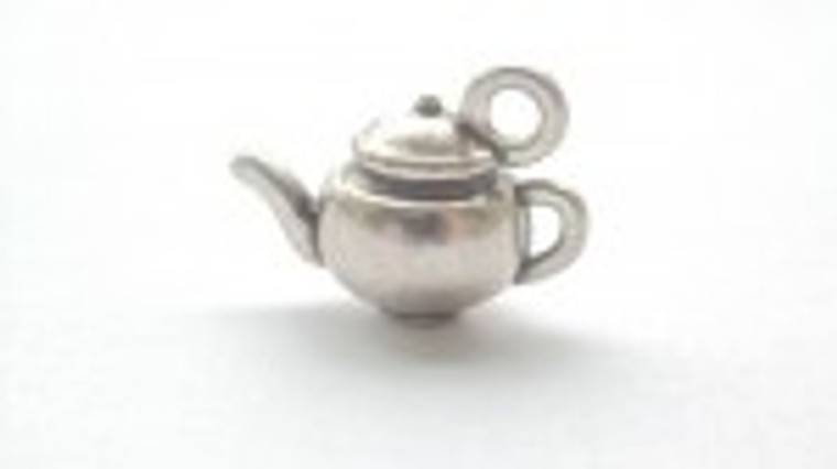 Scrapberry's - Metal Charms - Silver Tea Pot - 10 pcs - (SCB250112630)  Scrapberry's pack of 10 metal charms/embellishments. Silver Tea Pots, approximate size of each charm = 15x5mm.  These items are not toys, and are not suitable for children.  They are designed for use as charms or embellishments in all your scrapbooking projects, card making and much more.