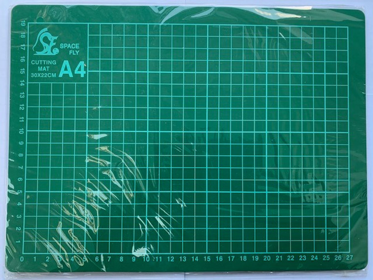 A4 Green Cutting Mat (220x330x3mm) - TA9020  A4 Green Cutting Mat.  This Mat has a special non-slip surface for cutting paper, card and other materials without damaging work surfaces.  This Mat has helpful marked guides to help you cut your cards and project pieces accurately.