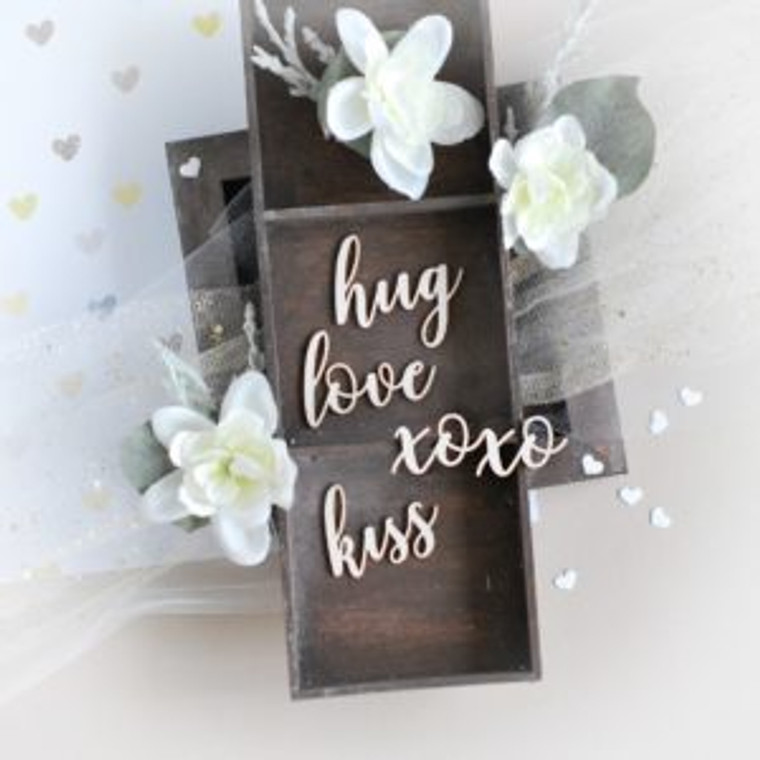 Bloomar - Words 032– Decorative laser cut chipboard (W032)  ' love ' , ' hug ', ' kiss '  ' xoxo ' decorative laser cut chipboard element.  Chipboard makes great everything- cards, layouts, albums, guest books, frames etc. It's perfect for scrapbooking, cardmaking and all sorts of craft. It will add dimension to all projects. You can decorate the chipboard element to perfectly match your project. You can paint it with your favourite colour of acrylic paint. Cover it in pigment ink and embossing powder, ink gold, distress ink, paste, pigment powder etc. Make it sparkle by adding glitter, rhinestones or embellish with tiny pearls.  1,2 mm thick white chipboard  Size of largest element : 5cm