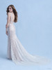 This Ariel inspired gown is playful yet elegant. A subtle flared train is reminiscent of a mermaid's silhouette while sparkling sequins mimic the play of light across the moonlit sea.