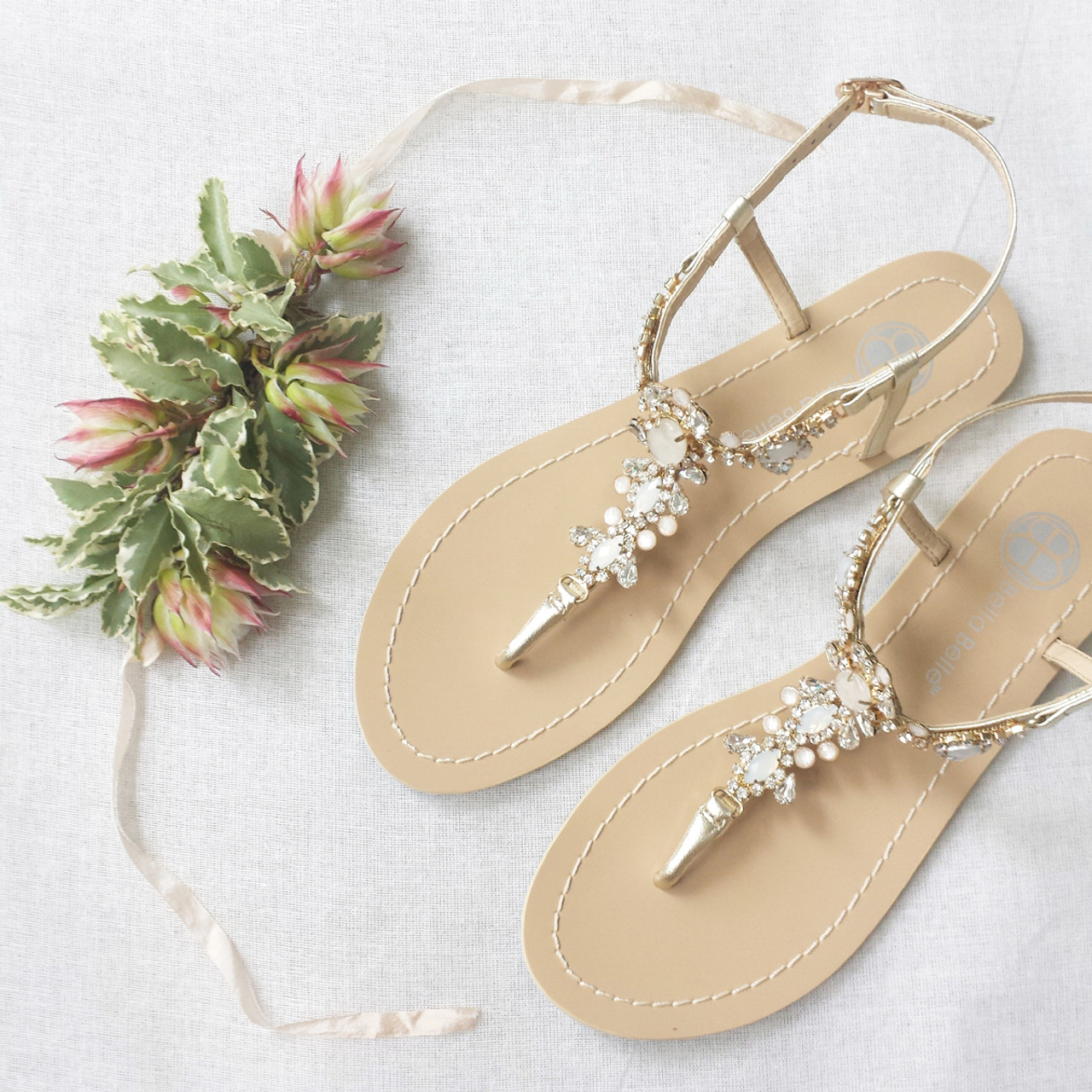 7383f69b4 Thong sandal Vintage-inspired rows of crystal jewels and white onyx-like  stones Jewels