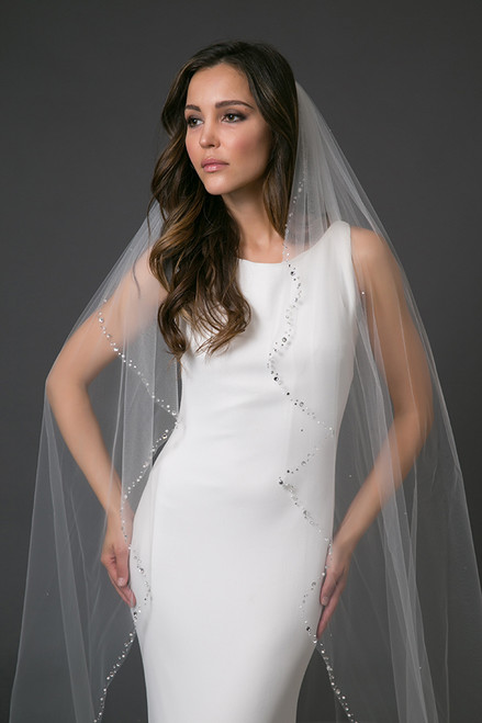With softly cascading sides and a full train, Prima features a classic shape to finish a gowns silhouette. The border is heavily encrusted with a variety of Swarovski crystal and pearl sizes for an enticing finish.