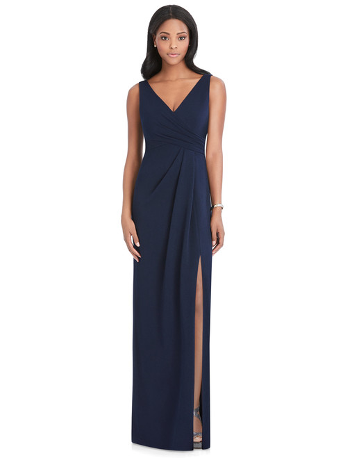 Full length sleeveless stretch crepe dress w/ draped wrap bodice and low v-back. Draped detail and slit at side front skirt. Sizes: small,medium,large