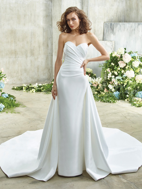 Old Hollywood glam meets modern minimalism in this sleek, stunning, stretch Mikado beauty. Edna features a hybrid sheath and A-line skirt that is chic, clean lines from the front, and full, dramatic gorgeousness in the back. A classic strapless sweetheart neckline is updated with thoughtful, figure-flattering ruching on the bodice that transitions to an exquisite illusion tulle corset back with sparkling, beaded floral embroidered lace.