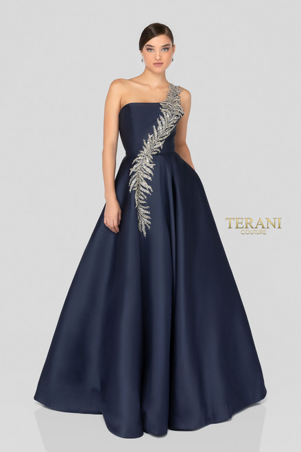 Elegant one shoulder Mikado long ball gown features an intricate leaf motif in metallic embroidery layered with matching beads and crystals. Sheer straps support the scoop back for a perfect fit. Finished with inset side pockets.