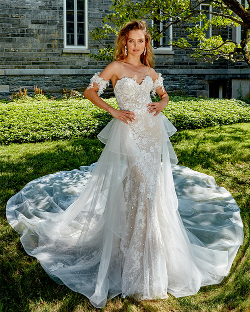 sculptured neckline with hand beaded three dimensional lace with matching cuffs, lightly hand beaded all over lace fit and flare gown, sparkle underneath top layer, with removable hand embroidered three dimensional chapel train