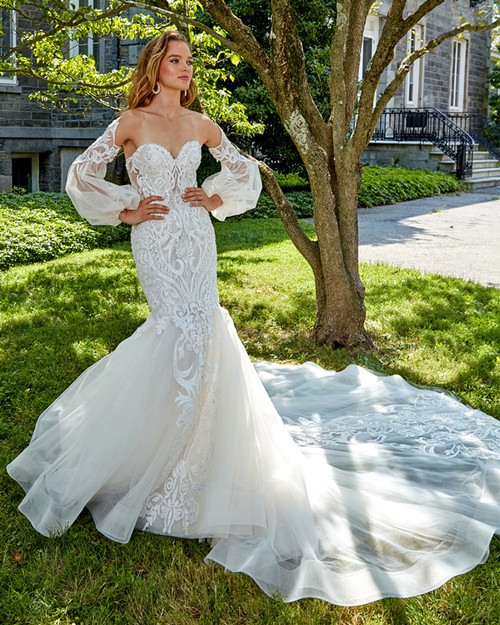 strapless sculptured neckline, soft hand beaded lace fit and flare gown, removable sheer lace sleeves, matching lace on the front and back of skirt, horsehair, chapel train