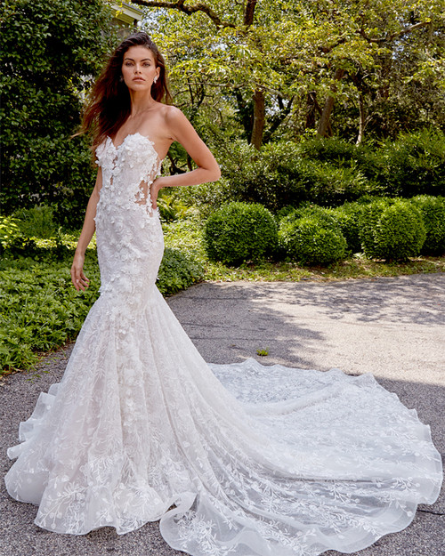 lightly had beaded sculptured neckline, fit and flare silhouette with sheer bodice, all over three dimensional flowers, chapel train.