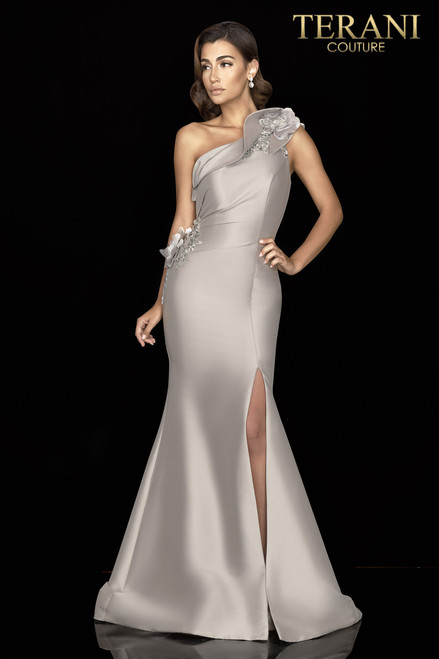 One shoulder mikado evening gown with twisted collar reveals lace tonal 3D flowers and its side tucks lead to a slit