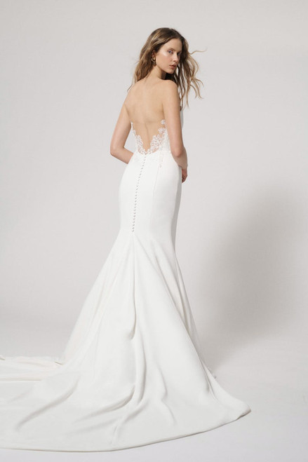 Strapless sculpted fit and flare gown with plunging illusion tulle back.