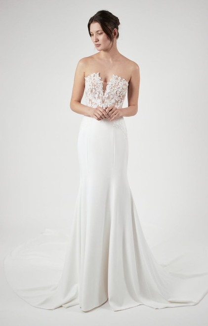 Strapless V-neckline gown with lace appliqued bodice and crepe skirt.