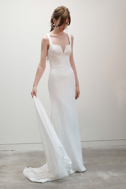 Notched square neckline sheath with open back wrapped in a couture bow