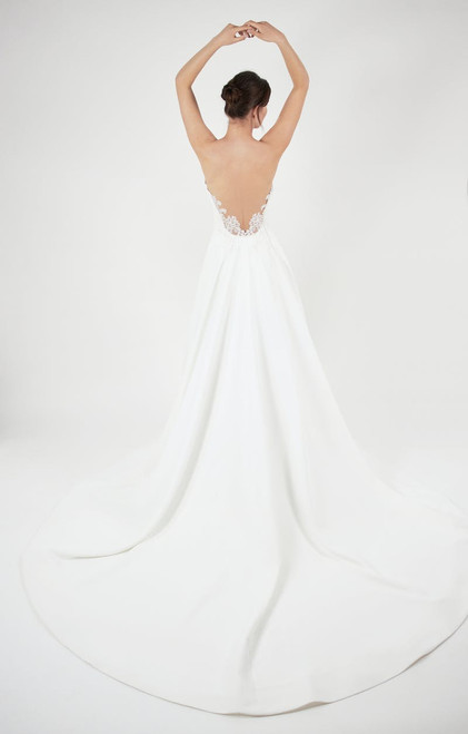 Voluminous ballgown with sculpted bodice, tattooed lace back detail and pockets.