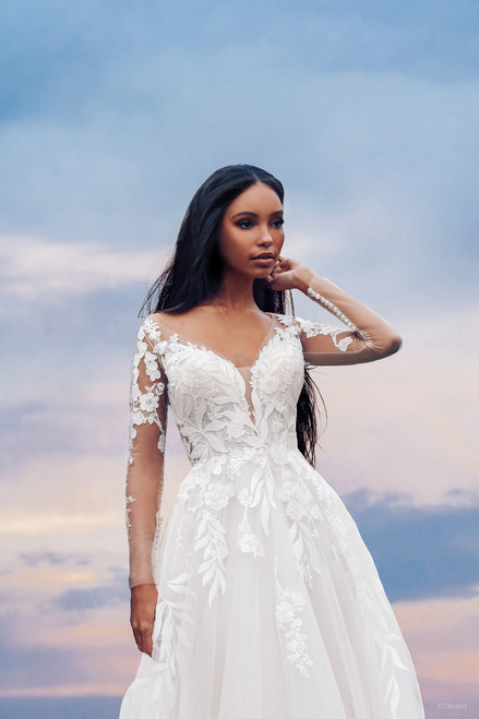 Inspired by her love of nature, the Pocahontas gown pays tribute to the 'Colors of the Wind' featuring delicately strewn patterned leaf appliques along the bodice and outlining the sheer illusion back and sleeves.
