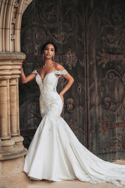Inspired by Jasmine's bold and adventurous spirit, this elegant gown features beautiful detailing with crystal embroidery and an off the shoulder neckline. The gown is highlighted by its striking illusion back with sparkling embroidery detail and elaborate cutaway lace train.